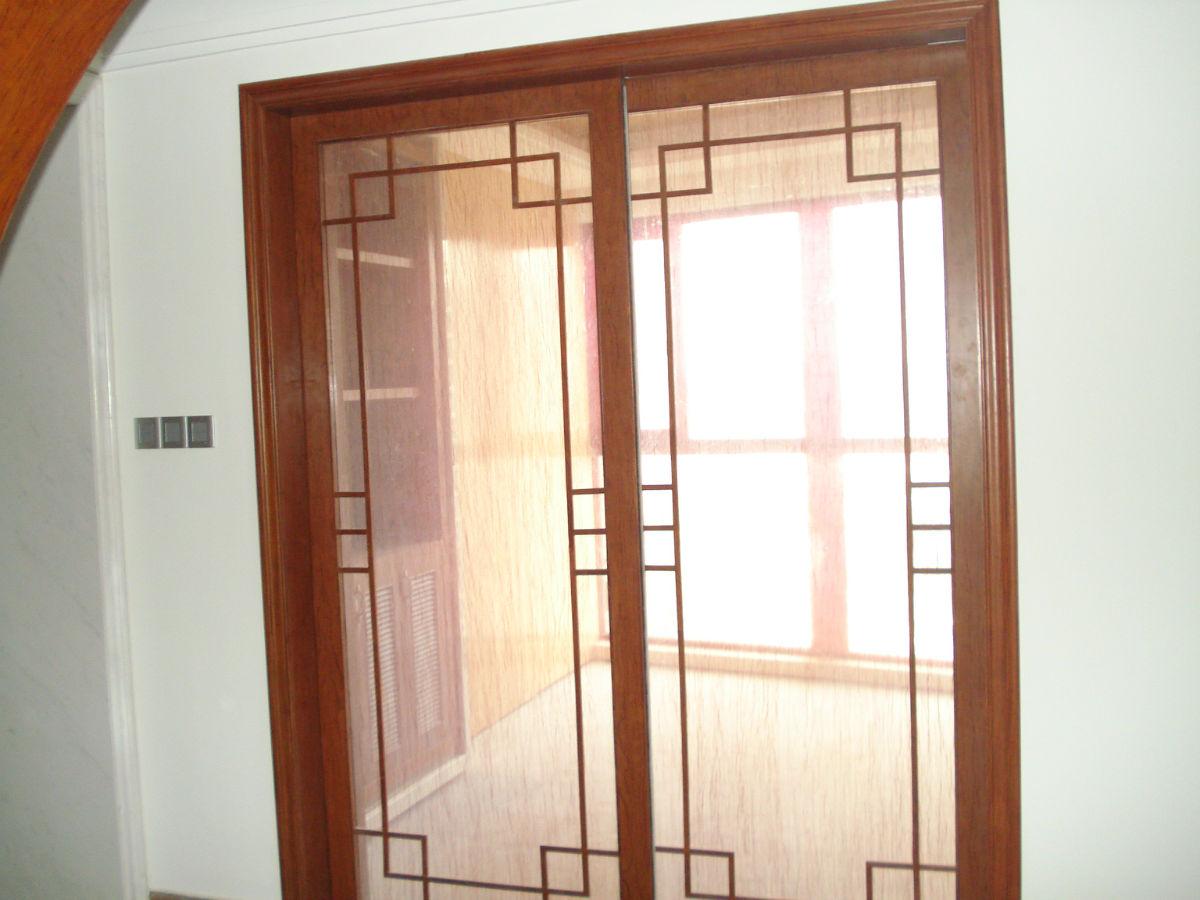 书房推拉门(中间拉丝玻璃+实木花梨线条)